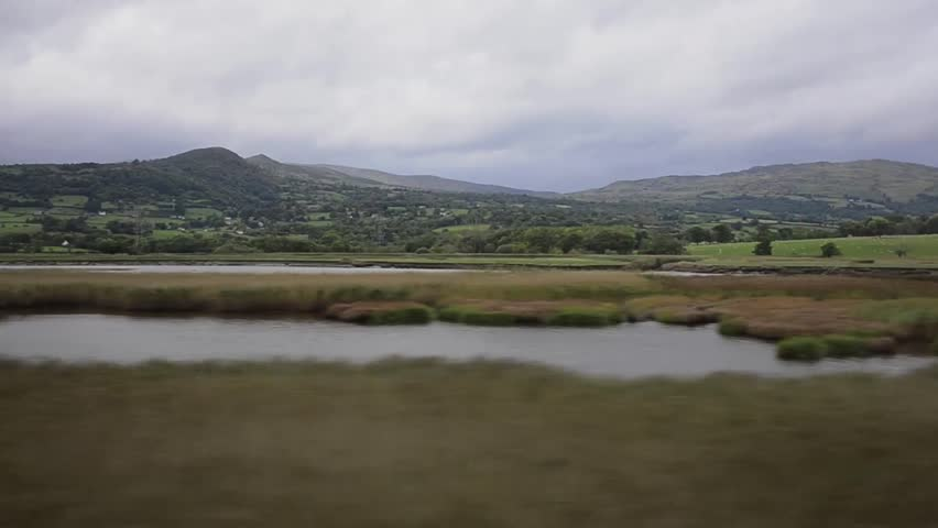 Aerial view of mountains with river and reeds along the Conwy river bank