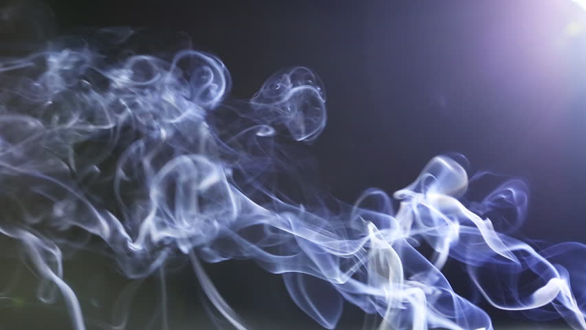 Movement of Incense Smooth Smoke on a dark background. Dynamic Beautiful calm relax concept. Aromatherapy, cleansing incense smoke