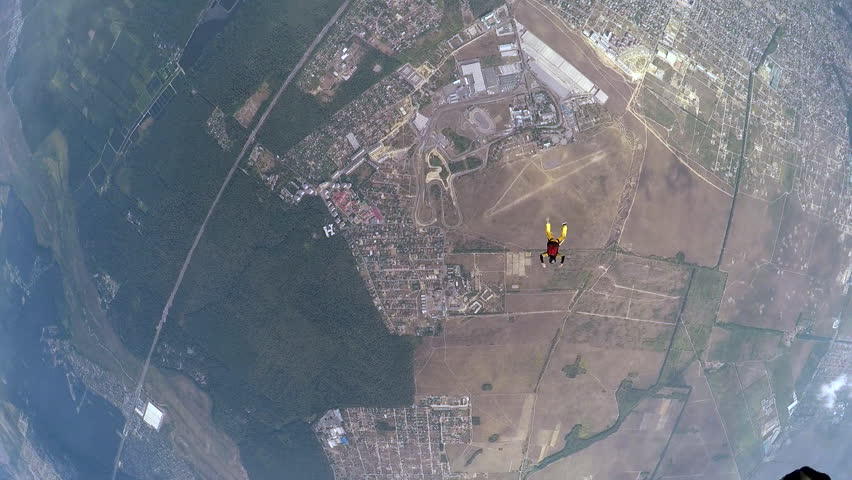 Skydiver sails in the sky during accelerated free fall course | Shutterstock HD Video #14100245