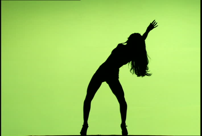 Womans Silhouette Dancing Against A Green Screen -8046