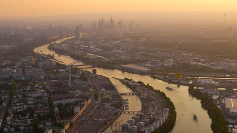 Frankfurt aerials. Flight with an ultralight plane over the river main towards the downtown of Frankfurt during sunset hour