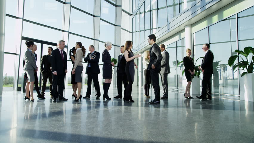 4k / Ultra HD version Diverse group of business people, stand and chat to each other in a light and modern glass fronted office building on a bright day. In slow motion. Shot on RED Epic | Shutterstock HD Video #14126954