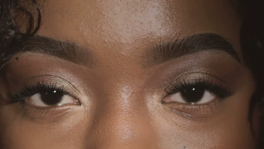 Beautiful young African American woman eyes closeup