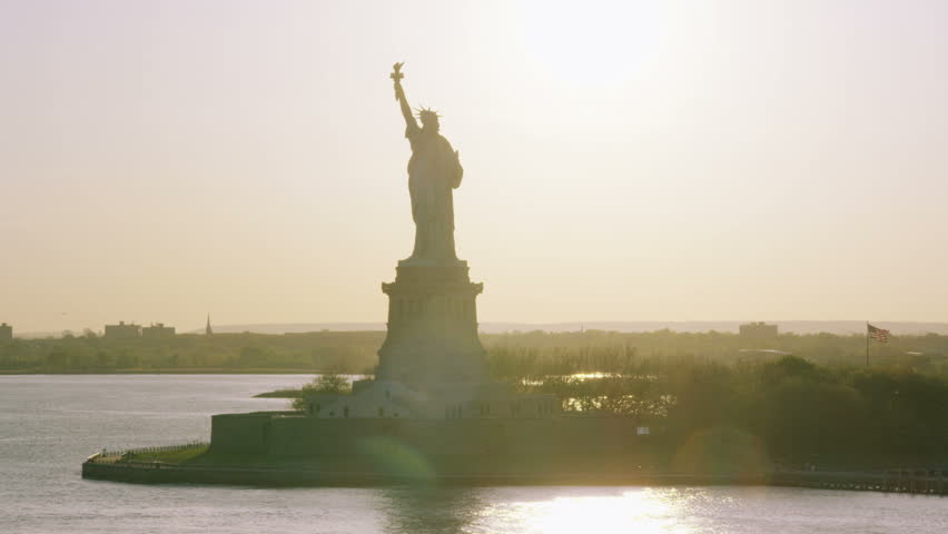 4k / Ultra HD version Helicopter aerial view of Statue of Liberty, New York City State. Flying overhead. Famous United States tourism attraction. Shot on RED Epic   Shutterstock HD Video #14172575