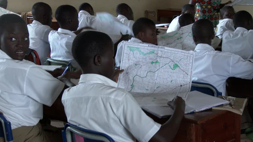 KAMPALA, UGANDA, OCTOBER 2015: African students studying geography at school using maps - Education in Africa #14204585