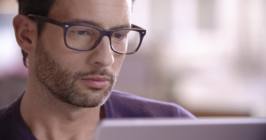 Close up young man relax work with tablet in the morning in slow motion (in real-time at 60 fps) | Shutterstock HD Video #14218445