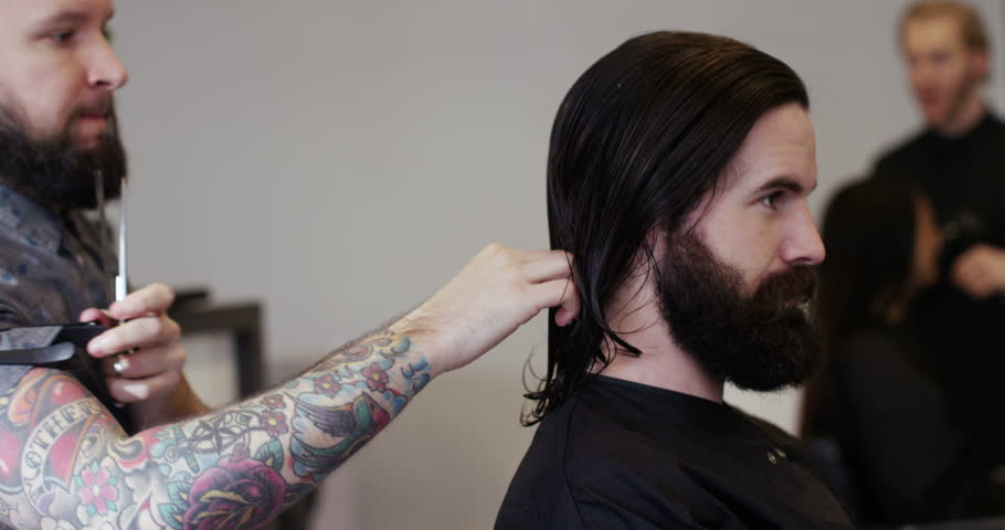 A young hipster man at a hairdresser.  #14220785