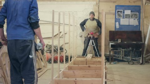 SAMARA, SAMARA REGION/RUSSIA - JANUARY 20: Start of construction of a boat at the shipyard, workers install the frames on the slipway on January 20, 2016 in Samara