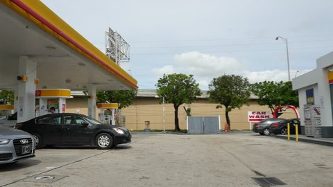 MIAMI - JANUARY 28: Stock video of a Shell Gas Station and convenient store in Midtown Miami shot with a gimbal stabilized video camera in motion January 28, 2016 in Miami FL, USA