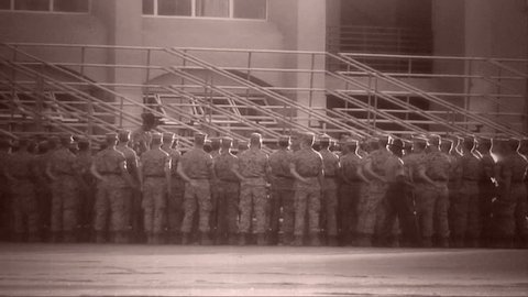 Archival shot of Marines standing at ease