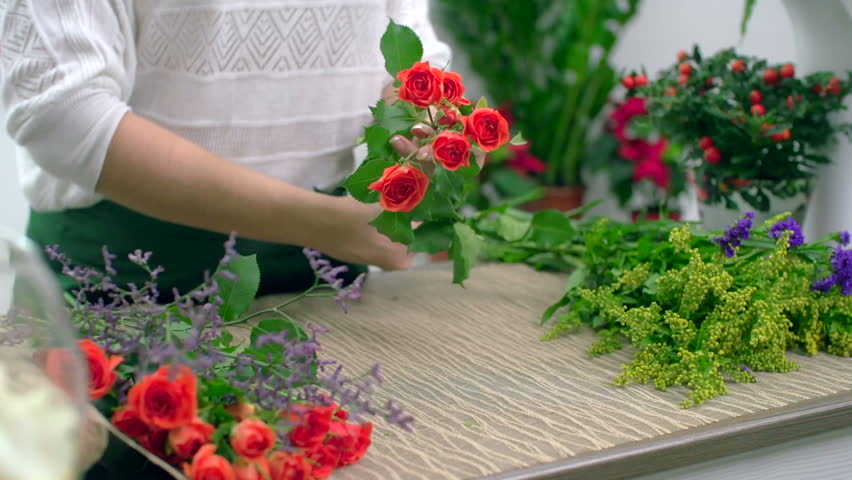 skillful design plant pots cheap. Hands of skillful floral designer conditioning red roses for arrangement  HD stock video clip Pick Flower Pot At Garden Plant Store Stock Footage Video