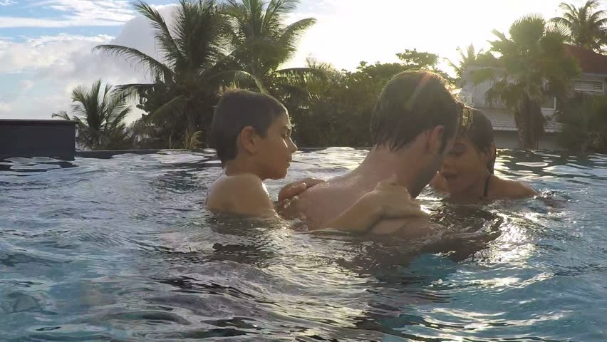 Man Playing With Kids In Swimming-pool Stock Footage Video 14294305