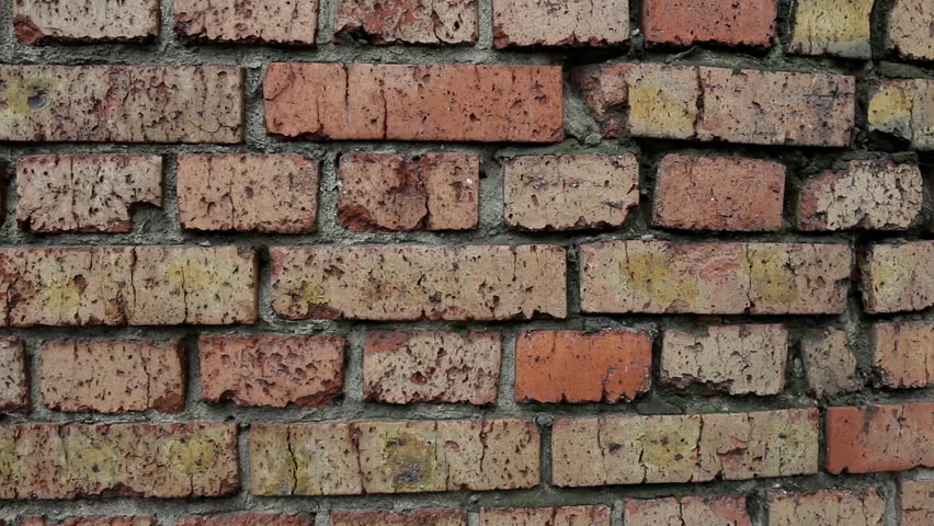 View of the old destroyed red brick wall. Macro shot.