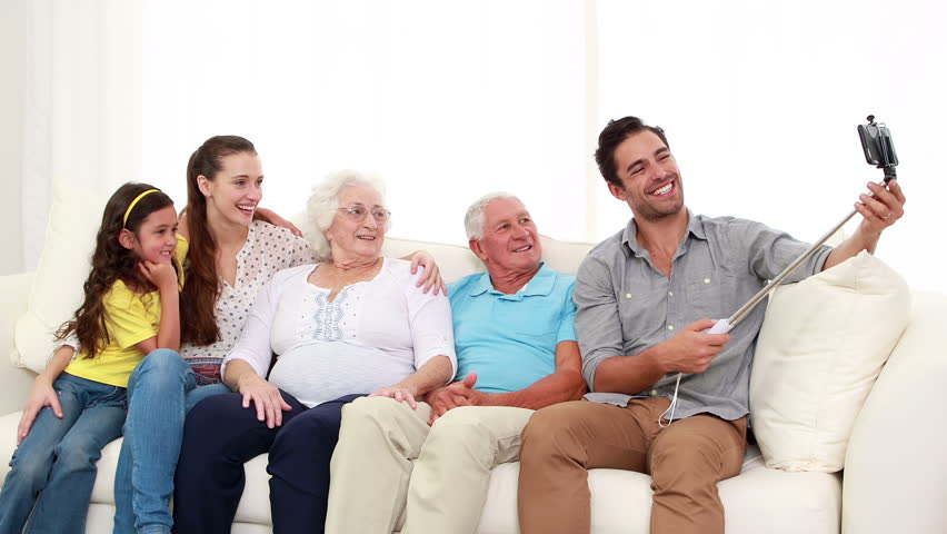 Happy Extended Family Taking Selfie On The Sofa   HD Stock Video Clip