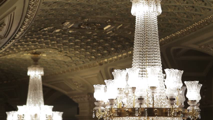 Interior of the old castle. Interior of the theater. Huge chandeliers in the theater. Chandeliers in the palace.