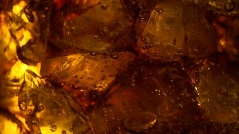 cola soft drink bubbles & ice, close-up
