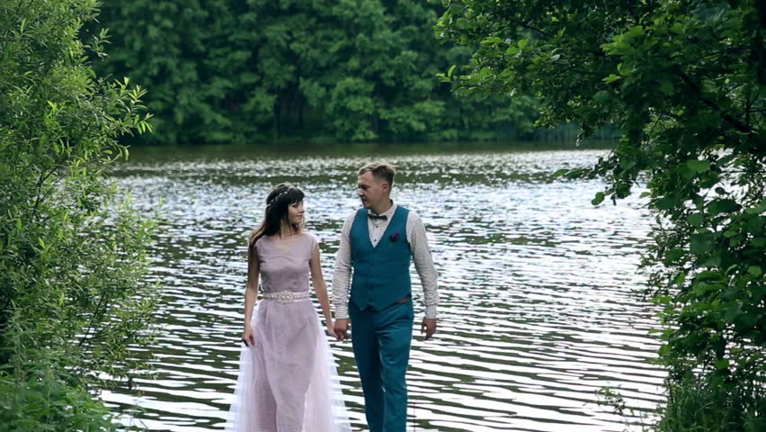Man and woman, young happy married couple near the lake. | Shutterstock HD Video #14398315