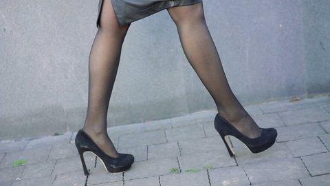 Sexy legs in walking on the street