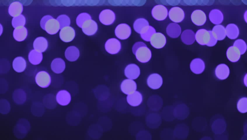 Ungraded: Violet bokeh randomly blinking. Source: DSLR, ungraded H.264 from camera without re-encoding. (av2502u)   Shutterstock HD Video #14417305