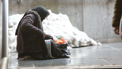 Anonymous woman is begging in the street of Sofia. Bulgaria is the poorest country in the European Union. HD.