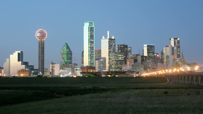 City lights illuminate the Dallas skyline at night.
