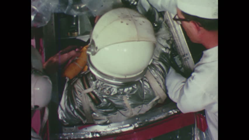 UNITED STATES 1960s: Men Help Astronaut into Space Capsule Ready for Launch | Shutterstock HD Video #14484235