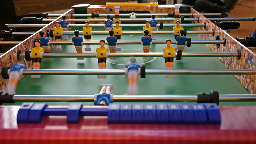 Father and child play kicker table football soccer. Baby-foot game. 4K UHD video footage.