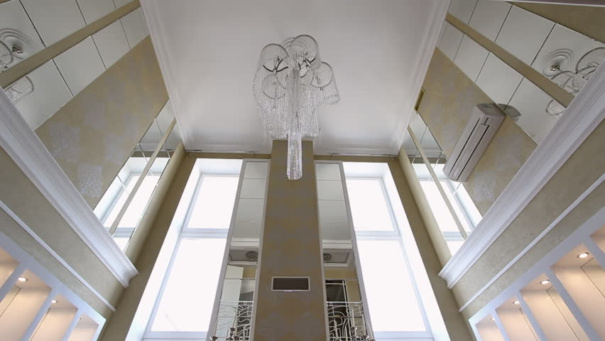 A Large Crystal Chandelier On The Ceiling View Showcase Of Modern Elegant Luxury Apartment Interior