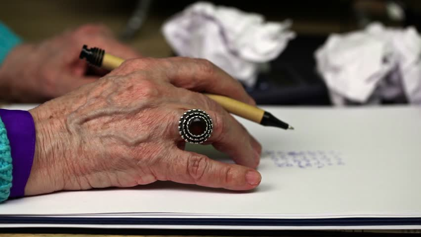 Old woman nervously keep hand on paper   Shutterstock HD Video #14510095