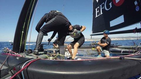 CIVITAVECCHIA, ITALY, AUGUST 27: sailors race on foiling catamaran GC32 Oman Sail during regatta, on August  27, 2015 in Civitavecchia, Italy