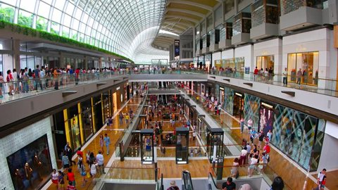 SINGAPORE - CIRCA AUG 2015: Luxury expensive brands shops promenade and customer inside of modern huge shopping mall The Shoppes at Marina Bay Sands