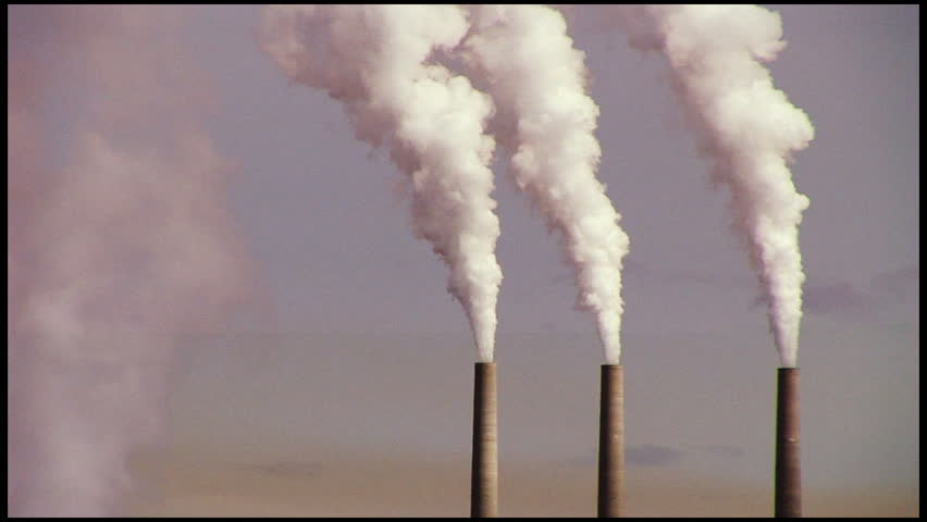 3 smoking chimneys from power station - HD stock video clip