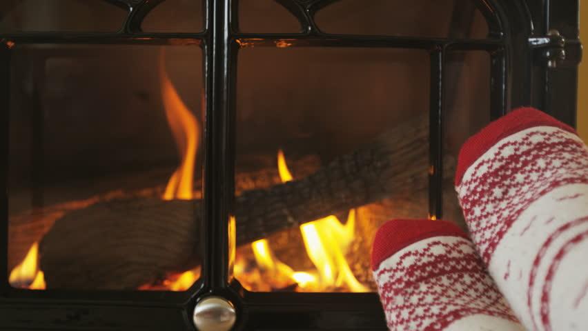 Feet In Socks Warming By Fire In Fireplace. Girl Is Wearing Socks ...