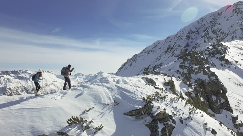 Climbers Walking Up Mountain Expedition Aerial Flight Epic Mountain Range Climb To Success Beautiful Peak Winter Vacation Exploration Adventure Hiking Tourism Concept | Shutterstock HD Video #14596555