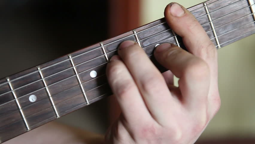 Man Plays Guitar His Fingers On The Fretboard Closeup Stock Footage Video 14624065