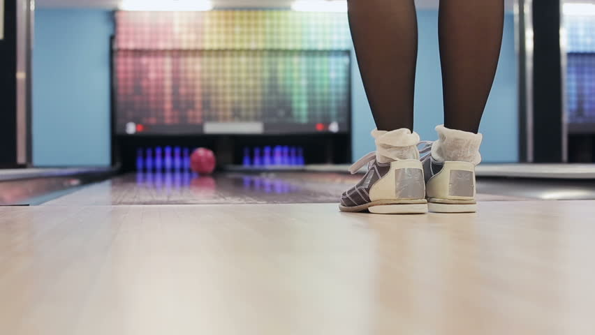 Woman is winning in a bowling game