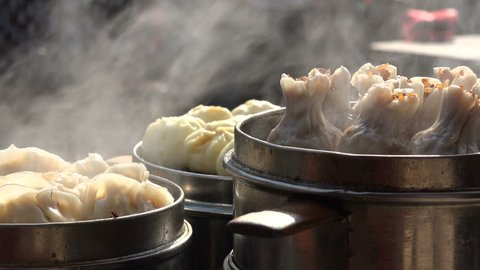Freshly cooked steamed buns and dumplings for sale in a small restaurant in Beijing, China