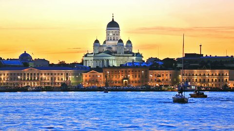 Scenic evening view of the Old Town architecture and pier with Market Square and Lutheran Christian Cathedral Church at the Senate Square in Helsinki, Finland