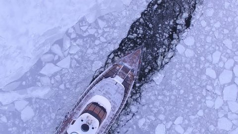 Cruise ship, icebreaker from above. Beautiful frozen WINTER Moscow city cowered in snow and ice. Aerial FPV Drone Flights. UltraHD 4K
