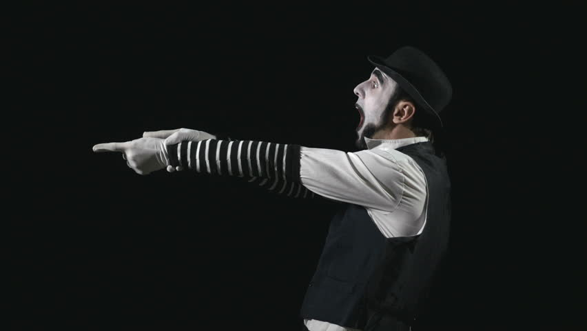 Young funny mime pointing and performing a comedy pantomime act