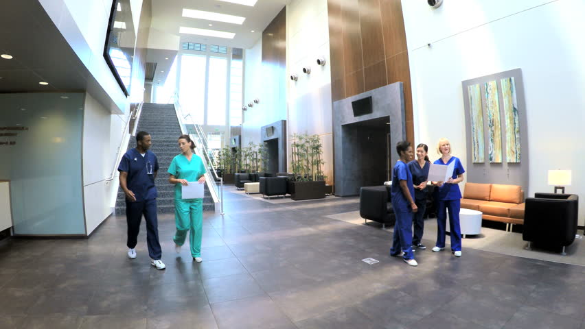 4K Time Lapse Of Medical Staff And Patients In Busy Modern ...