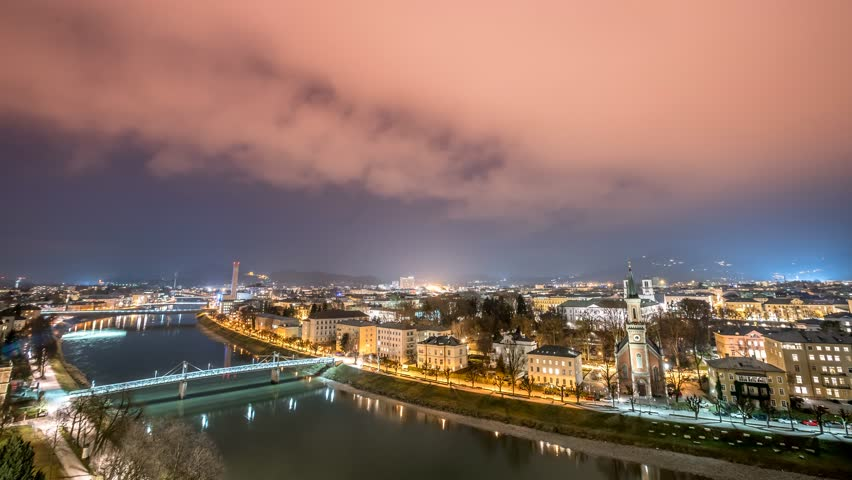 Panoramic Night Time Lapse scene over Salzburg in 4K.