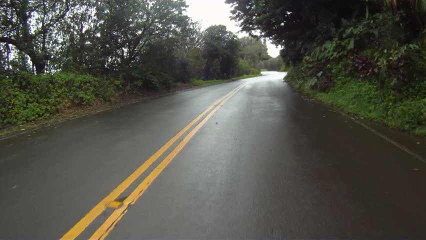 POV driving onto rainy road - coastal Maui