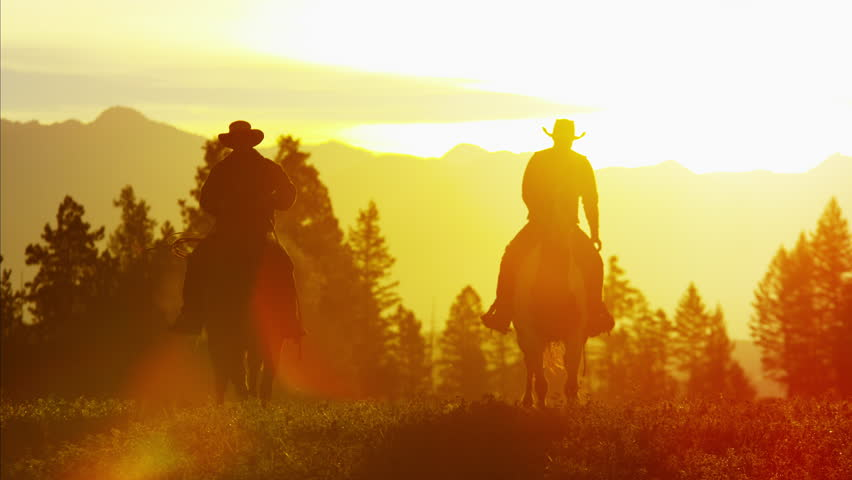 Silhouette reveal of Cowboy Riders in sunset wilderness Canada | Shutterstock HD Video #14724694