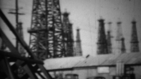 LONG BEACH, CALIFORNIA 1938: California oil drilling fields steel derrick tower rigging.