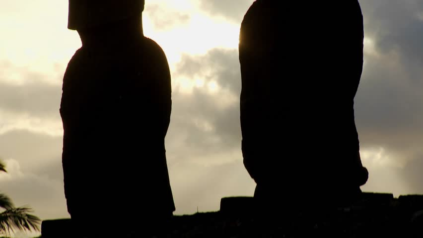 A tilt up reveals birds nesting on the topknots of Easter Island statues.