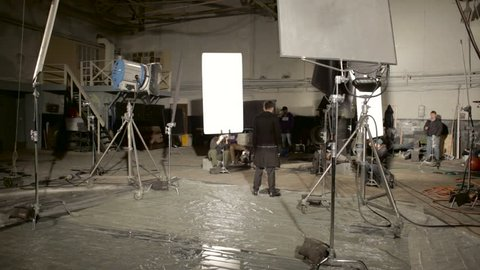 KIEV/UKRAINE - FEB 14 2016: indoor video passes, special equipment, large white reflectors cool, man character standing in front of the camera, a lot of specialized equipment