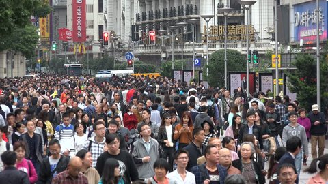 SHANGHAI, CHINA - 31 OCTOBER 2015: Locals and tourists (both domestic and foreign) walk through the busy Nanjing Road shopping street in Shanghai, China