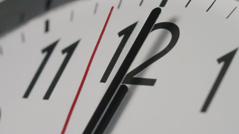 4K Slow zoom in to a clock face as the clock strikes midnight, or midday