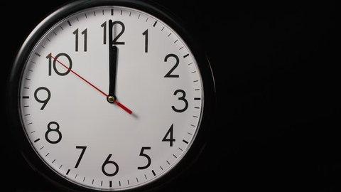 4K Circular wall clock ticking towards 12 o'clock